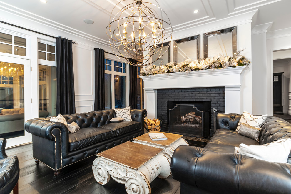 Inspiration for a transitional dark wood floor living room remodel in Edmonton with white walls, a standard fireplace, a brick fireplace and no tv