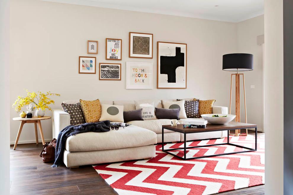 Living room - contemporary formal medium tone wood floor living room idea in Melbourne with beige walls