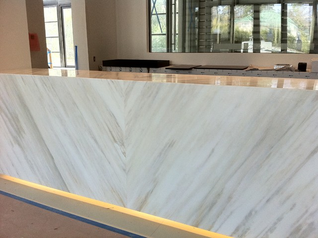 Bar With Suspended Counter Top Book Matched Calacatta Marblecontemporary Living Room Houston
