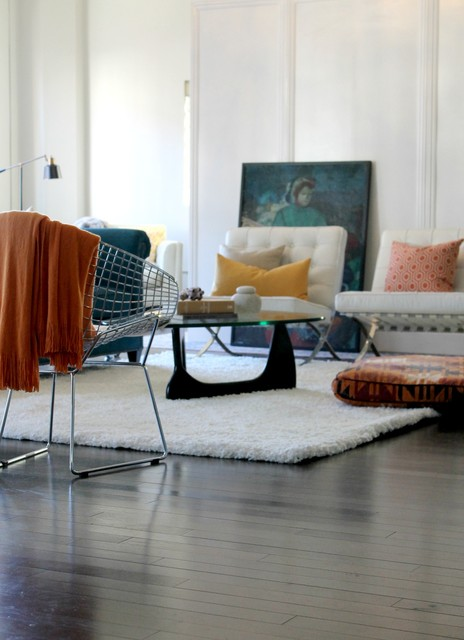 barcelona chairs noguchi coffee table with orange and teal color scheme