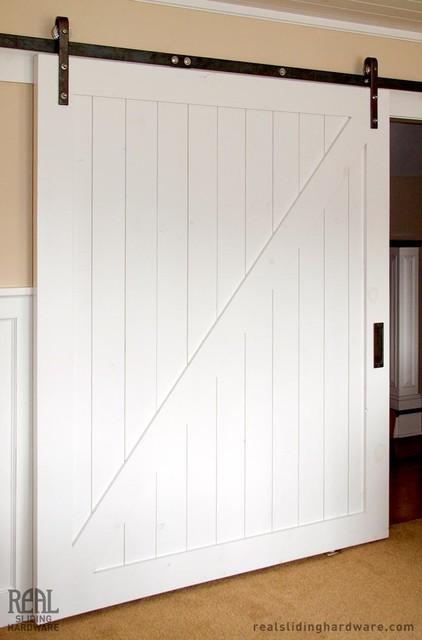 Barn door installations farmhouse living room other for Sliding barn door living room