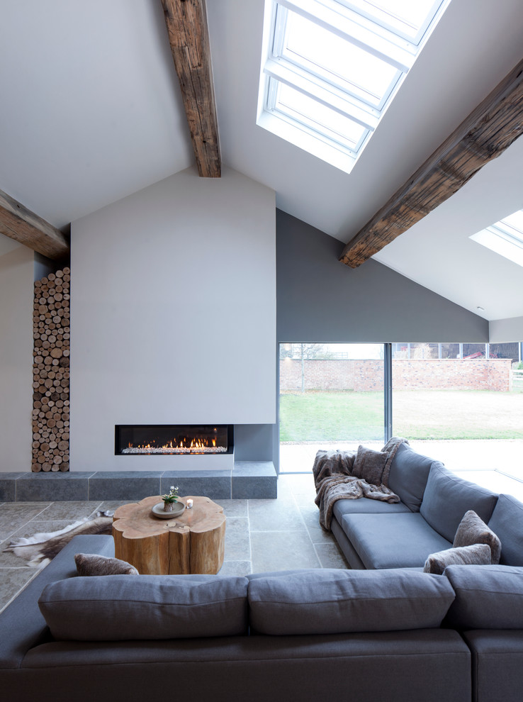 Inspiration for a large contemporary formal limestone floor living room remodel in Cheshire with white walls, a ribbon fireplace and a plaster fireplace