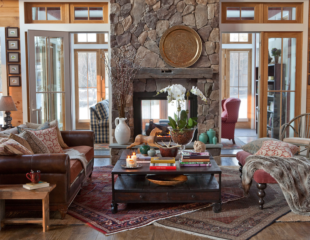 Living room - traditional living room idea in Other with a two-sided fireplace and a stone fireplace