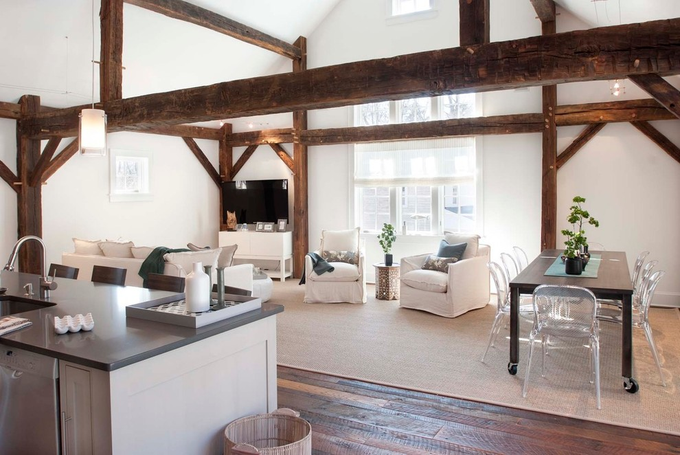 Example of a country open concept dark wood floor living room design in New York with white walls and a tv stand