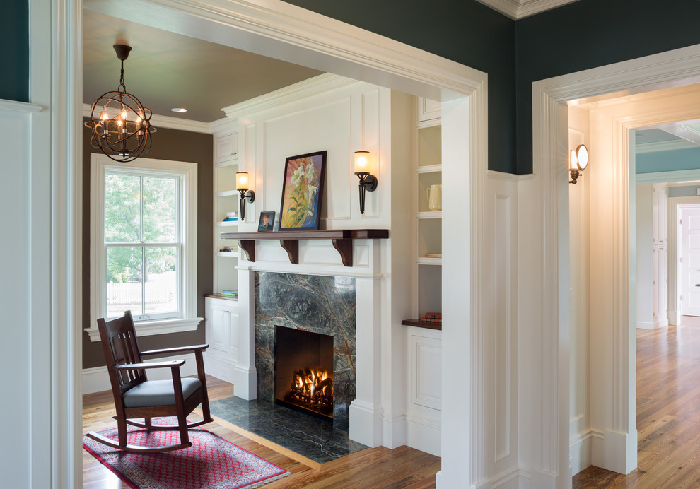 Inspiration for a small country formal and enclosed medium tone wood floor living room remodel in Providence with brown walls, a standard fireplace and a tile fireplace