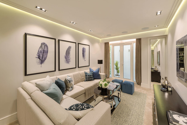 Photo of a classic formal enclosed living room in London with carpet.