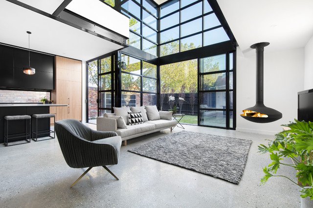 Living room - contemporary open concept living room idea in Melbourne with white walls and a hanging fireplace