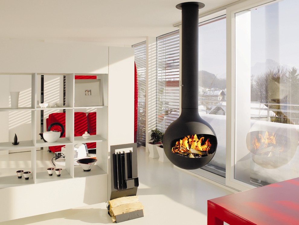 Trendy living room photo in Devon with white walls and a hanging fireplace