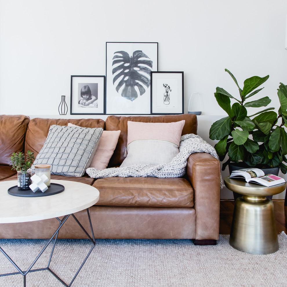 Living room - scandinavian medium tone wood floor living room idea in Melbourne with white walls
