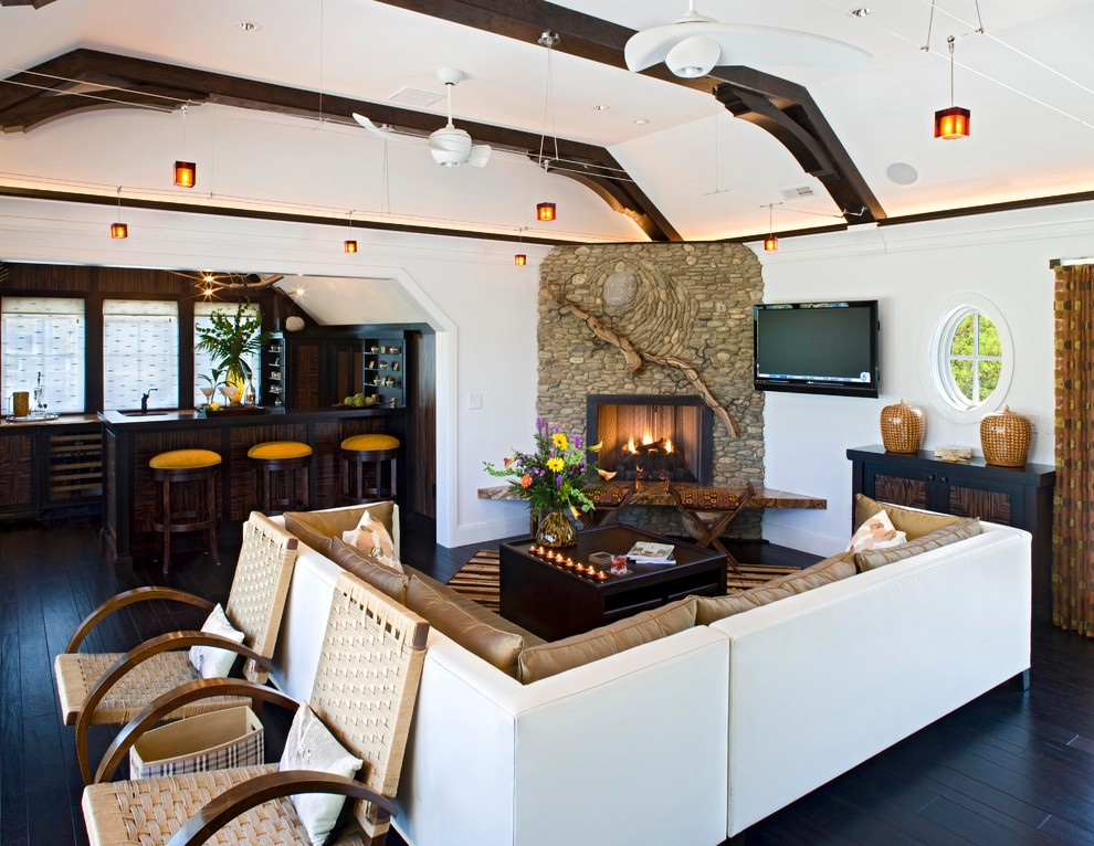 Beach style open concept living room photo in DC Metro with a bar, a corner fireplace, a stone fireplace and a wall-mounted tv