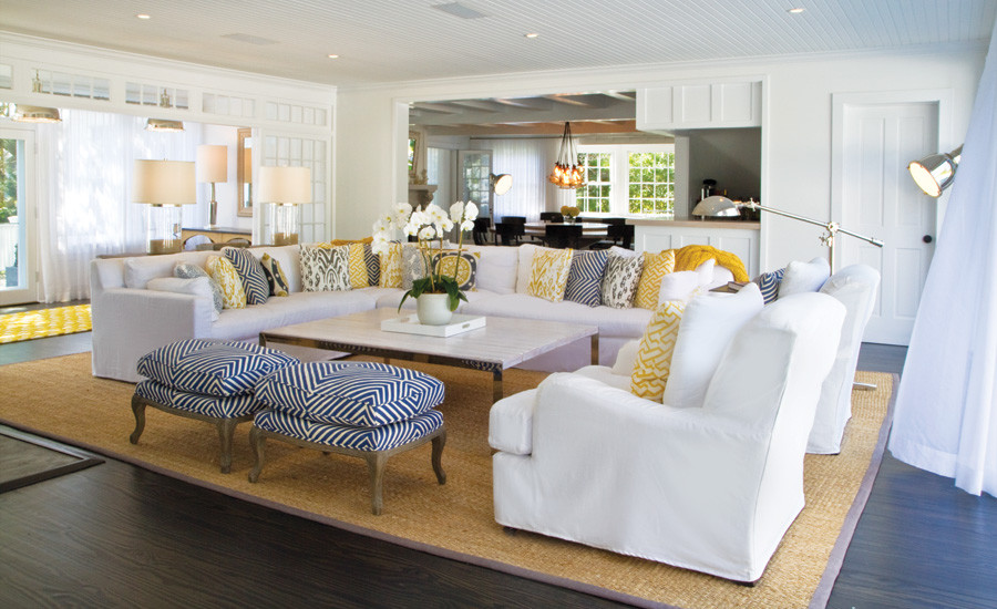 Example of a huge beach style formal and open concept dark wood floor living room design in New York with white walls and a standard fireplace