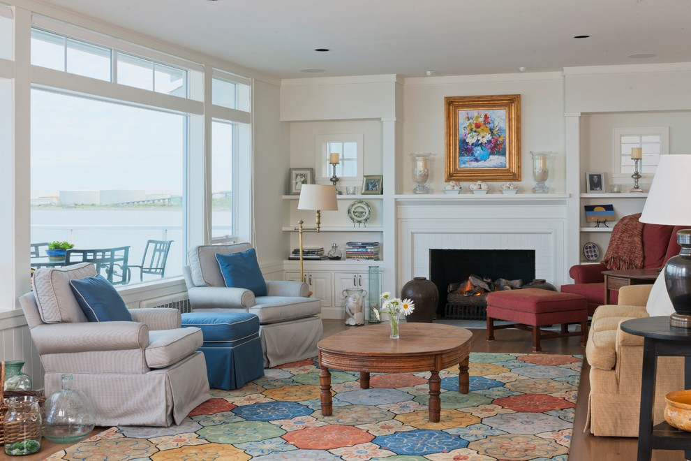 Example of a beach style formal living room design in Seattle with a standard fireplace