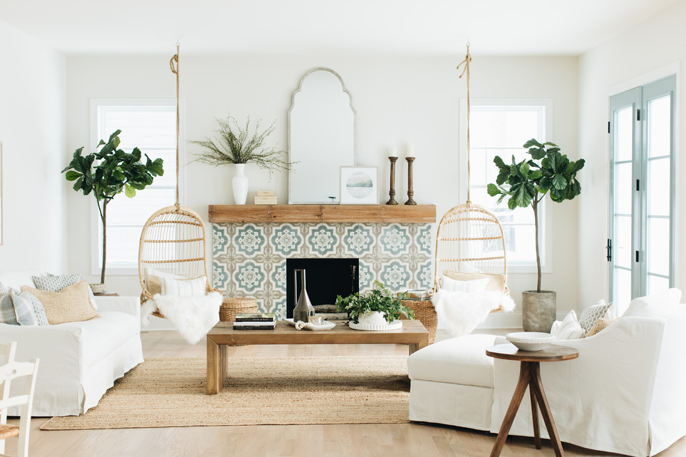 Living room - coastal formal light wood floor and beige floor living room idea in Chicago with white walls, a standard fireplace, a tile fireplace and no tv