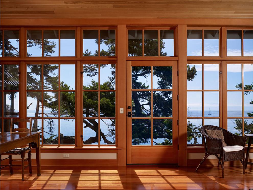 Living room - coastal medium tone wood floor living room idea in Seattle