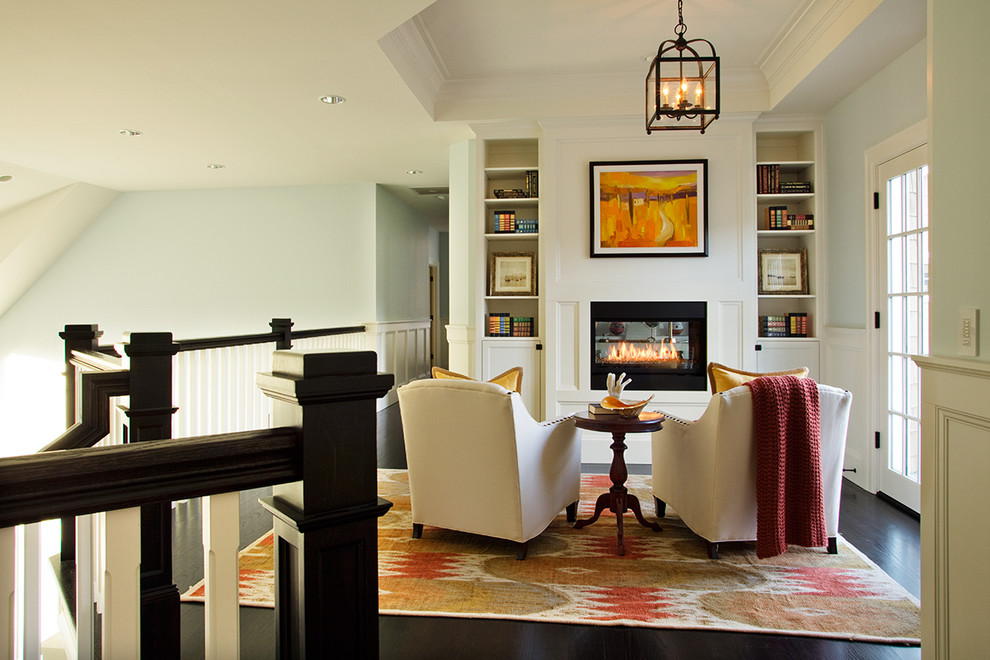 Example of a beach style loft-style living room library design in Portland