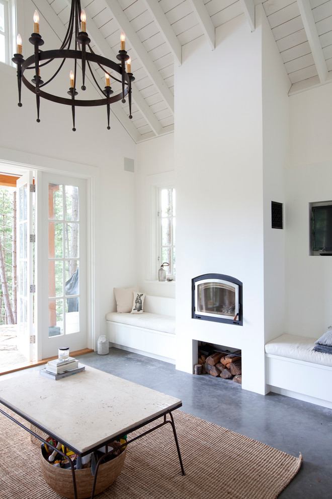 Inspiration for a coastal living room remodel in Vancouver with white walls and a standard fireplace