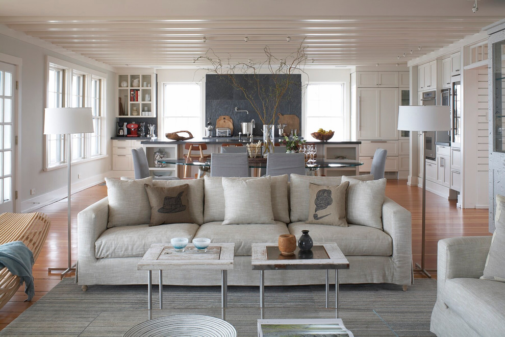 Example of a beach style open concept medium tone wood floor living room design in Providence