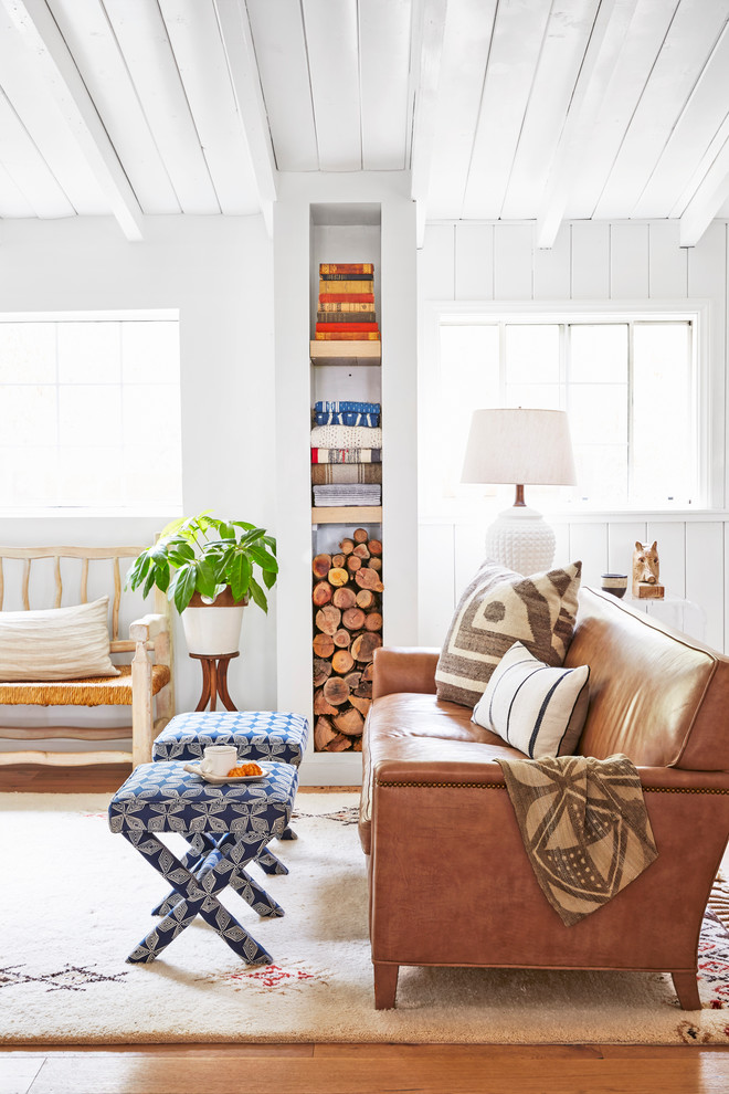 Living room - small coastal open concept light wood floor living room idea in Los Angeles with white walls