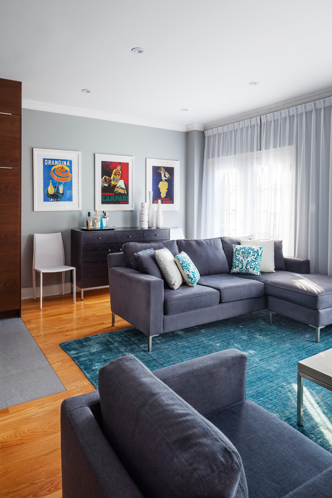Inspiration for a mid-sized transitional open concept medium tone wood floor living room remodel in Toronto with gray walls