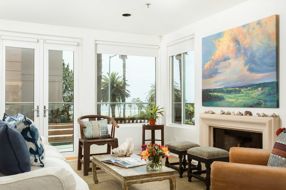 Living room - large coastal open concept carpeted and beige floor living room idea in Los Angeles with white walls, a standard fireplace, a plaster fireplace and no tv