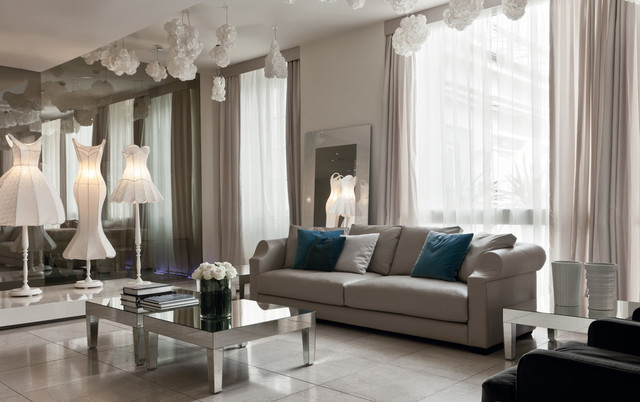 Beautiful beige living room with grey sofa and mirrored tables ...