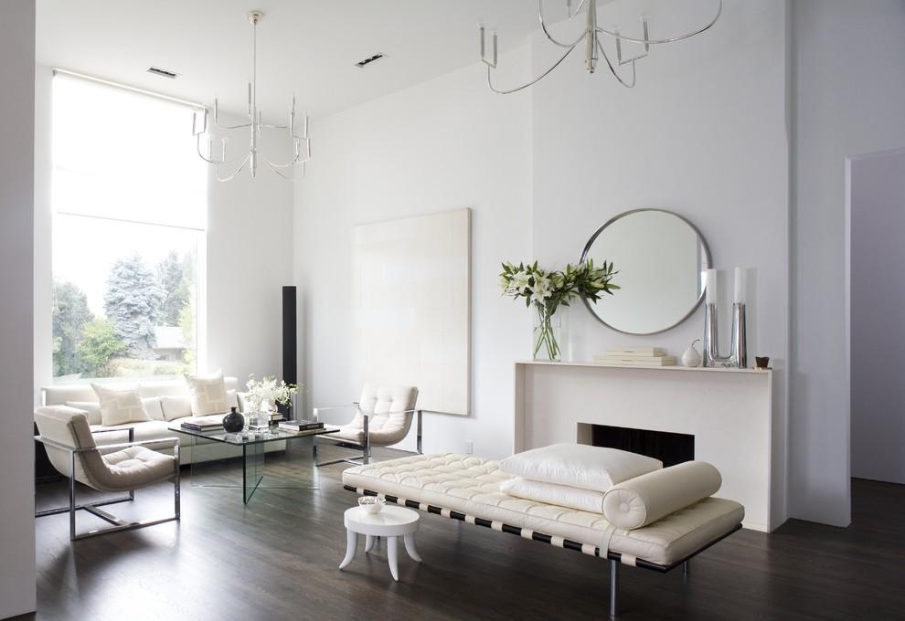 Inspiration for a modern dark wood floor living room remodel in Denver with white walls