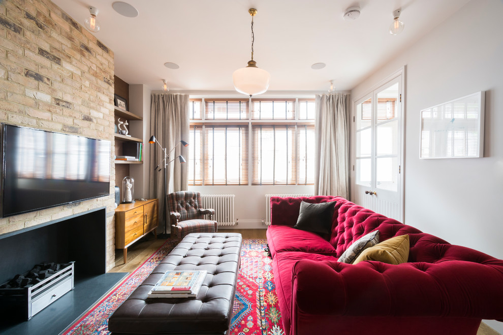 Inspiration for a timeless living room remodel in London with white walls, a ribbon fireplace and a wall-mounted tv