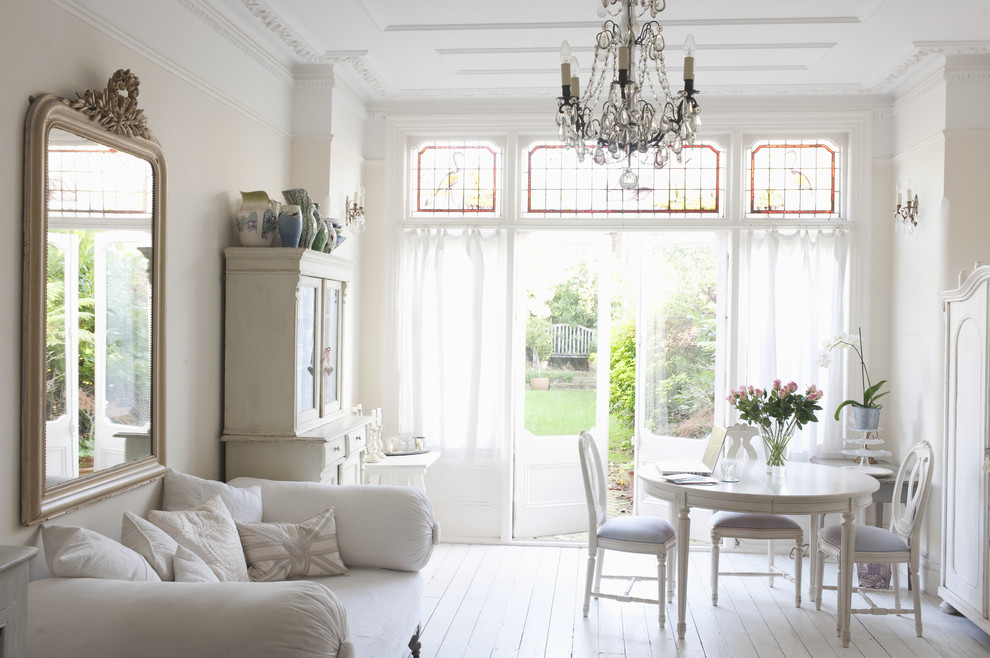 Example of a cottage chic open concept painted wood floor living room design in New Orleans with beige walls