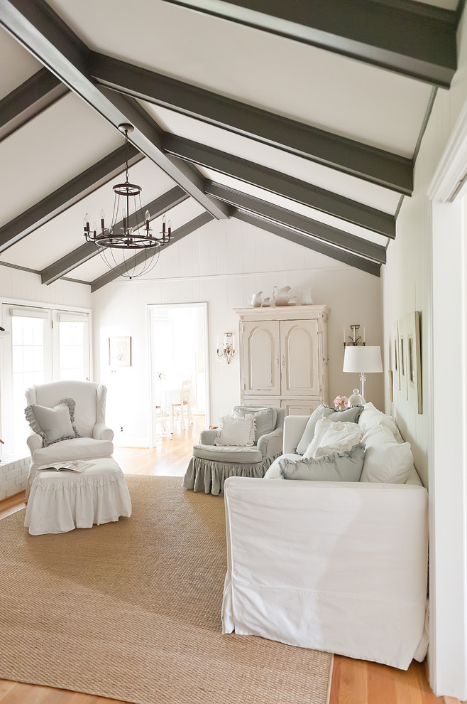 Inspiration for a timeless enclosed living room remodel in Nashville with white walls