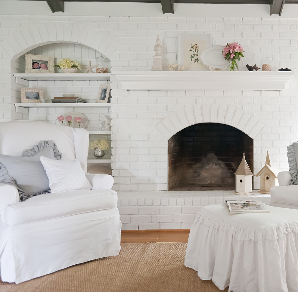 Example of a cottage chic living room design in Nashville with a brick fireplace
