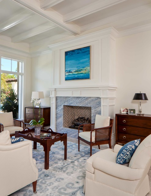 Island style formal living room photo in Miami with white walls, a stone fireplace and no tv