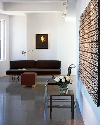Minimalist living room photo in New York with white walls