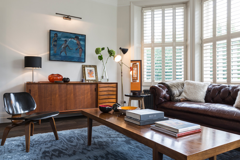 Inspiration for a 1950s formal dark wood floor living room remodel in London with white walls
