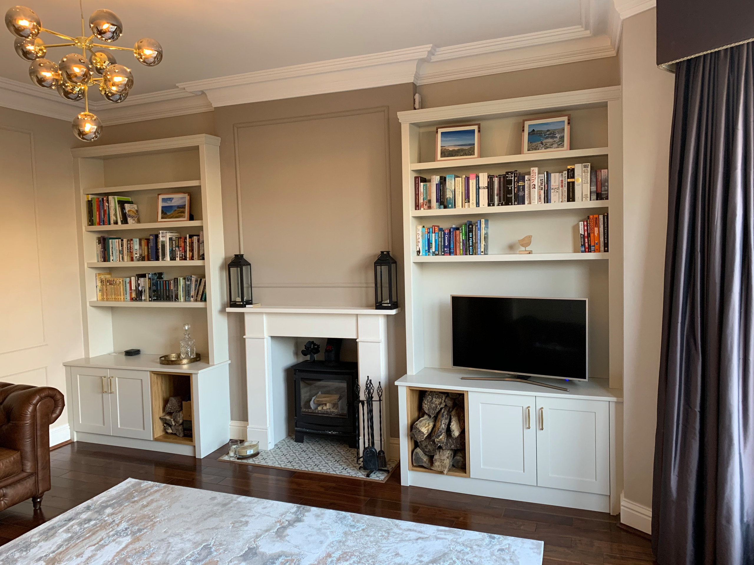 Bespoke Wide Alcove Cabinets with Log Storage and Lighting