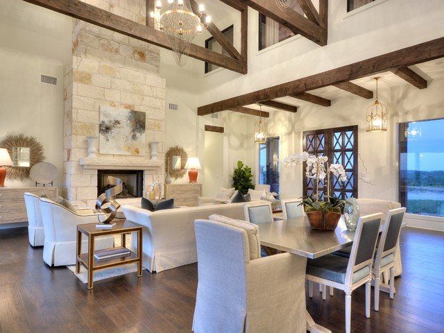 Hand-stressed wood beams and native stone fireplace add both drama and warmth to the great room.