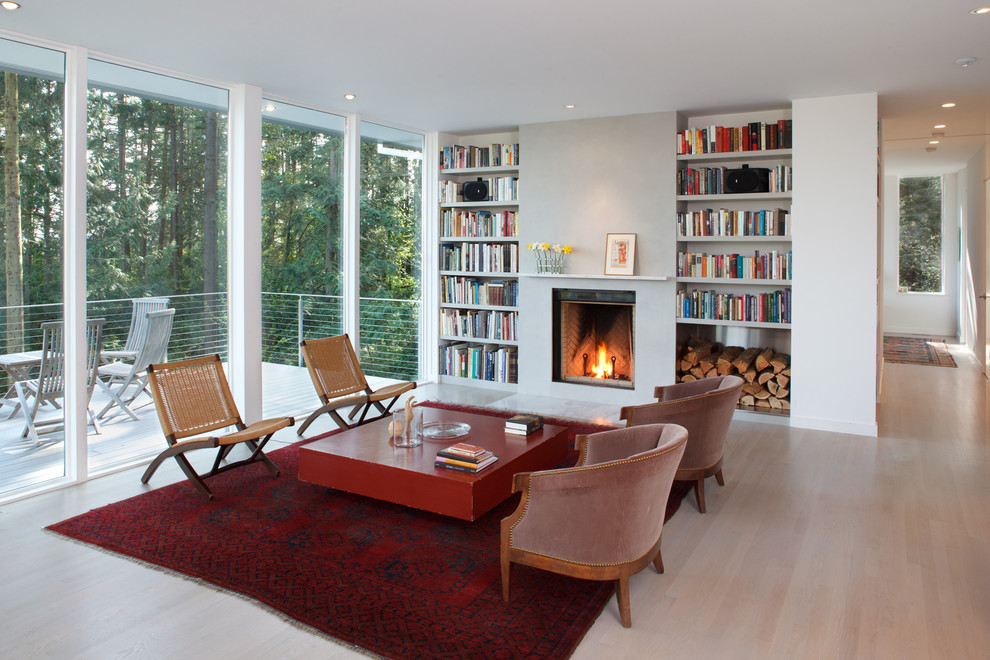 Example of a mid-sized trendy open concept light wood floor living room design in Seattle with a standard fireplace, a plaster fireplace, white walls and no tv