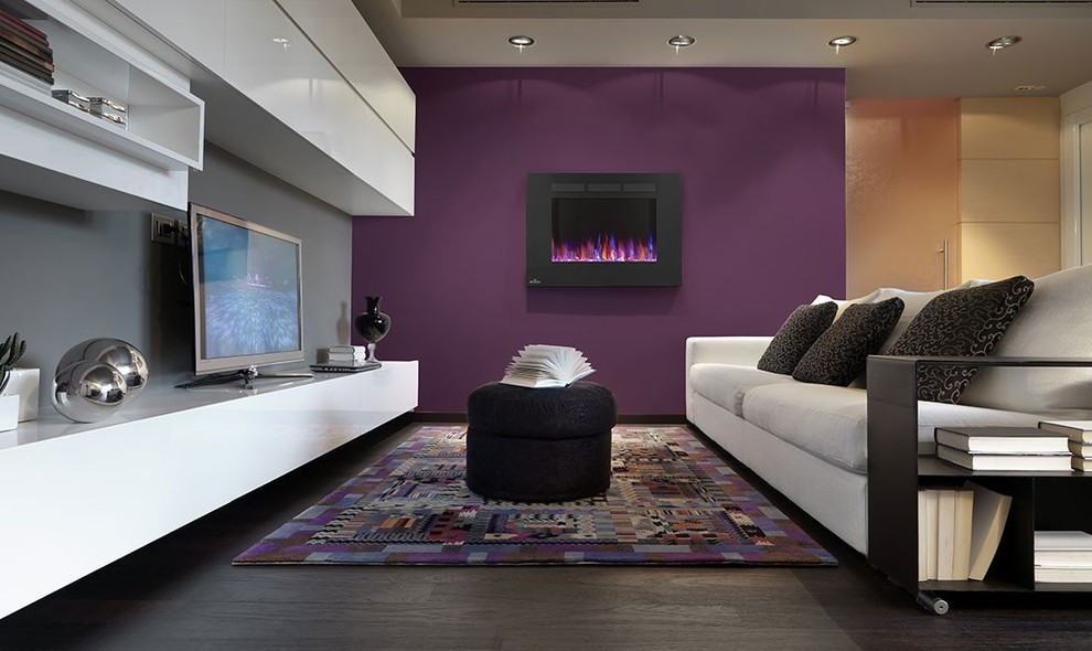 Mid-sized trendy dark wood floor and brown floor living room photo in New York with purple walls, a hanging fireplace and a tv stand
