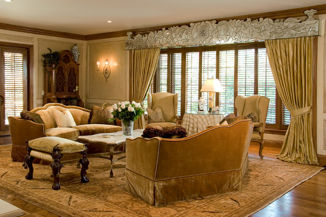 Huge elegant formal and enclosed medium tone wood floor living room photo in Los Angeles with beige walls, a standard fireplace and a plaster fireplace