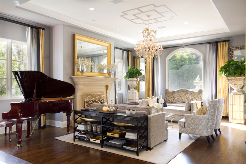 Example of a classic living room design in Los Angeles with a music area, gray walls and a standard fireplace