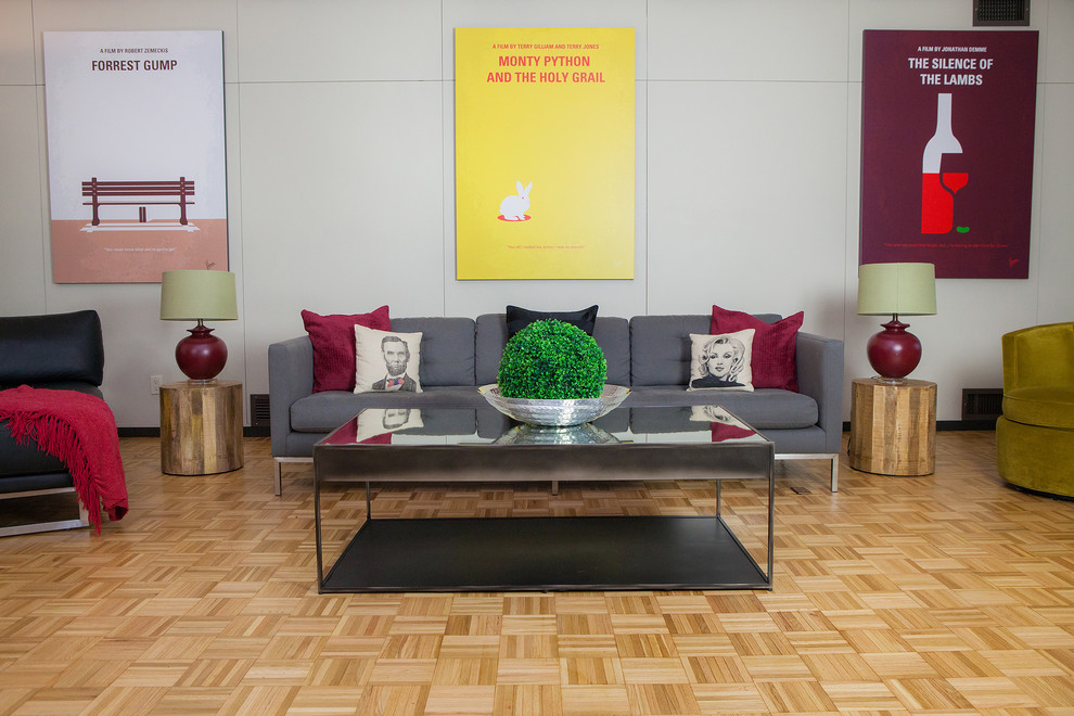 Example of a mid-century modern living room design in Columbus with white walls