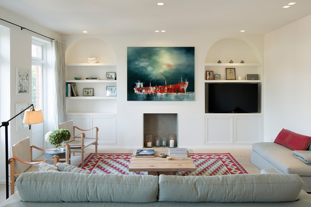 Inspiration for a large transitional open concept light wood floor living room remodel in London with white walls, a standard fireplace and a media wall