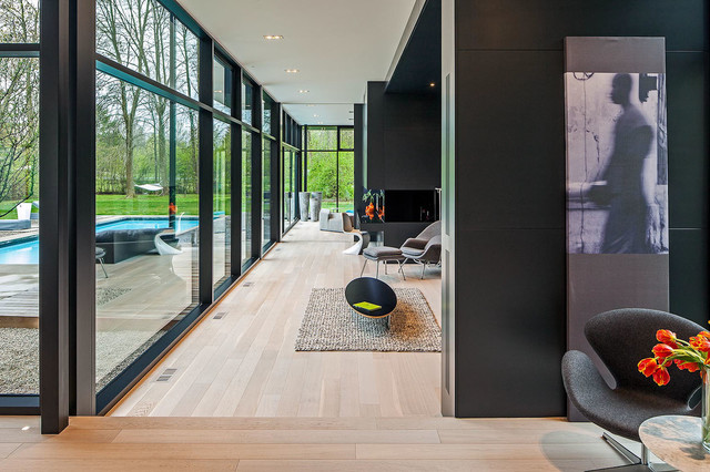 Example of a minimalist open concept living room design in Toronto