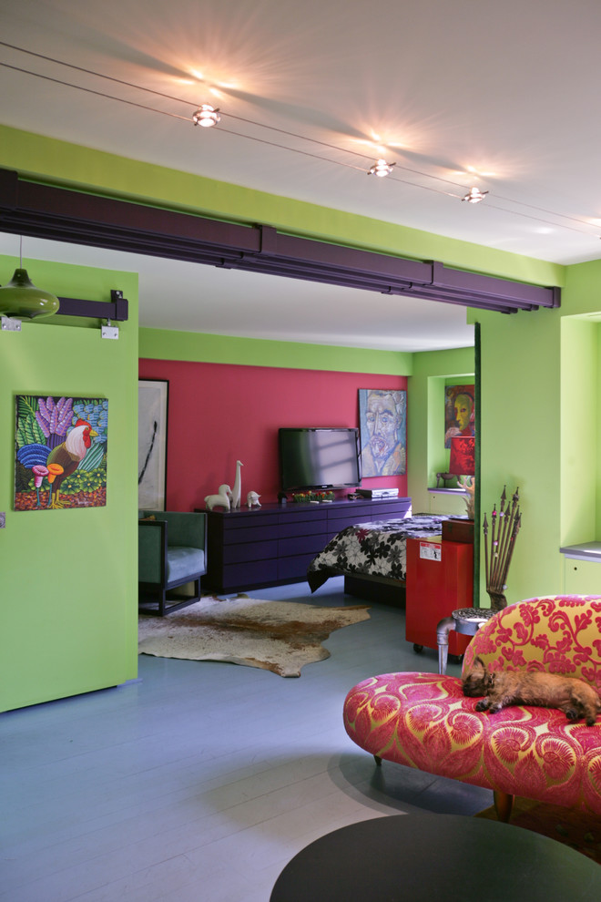 Living room - eclectic living room idea in New York with green walls