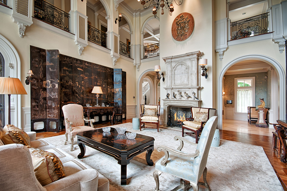 Inspiration for a victorian formal medium tone wood floor living room remodel in Other with beige walls, a standard fireplace and no tv