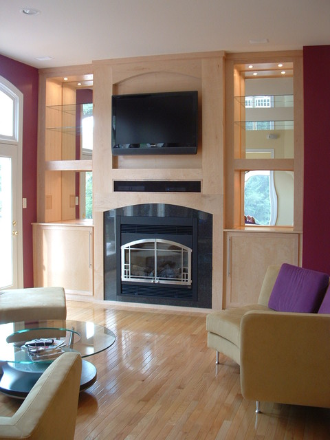 Custom designed and custom made Birds-eye Maple built-in entertainment center with fireplace