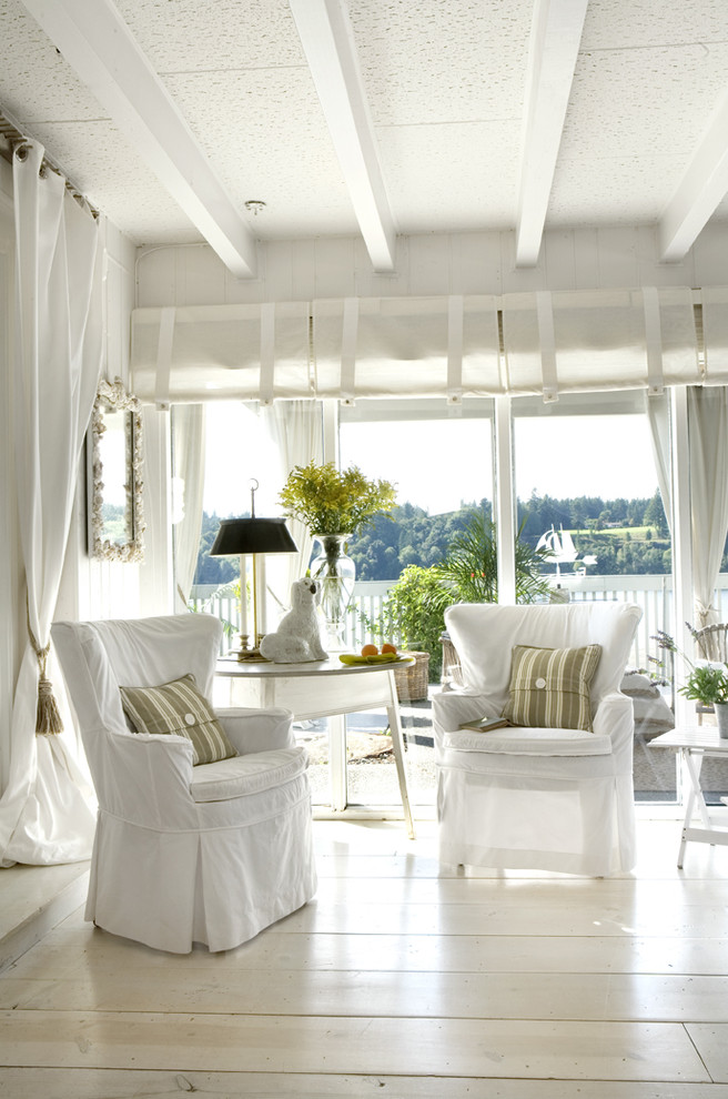 Inspiration for a contemporary light wood floor and white floor living room remodel in Portland with white walls