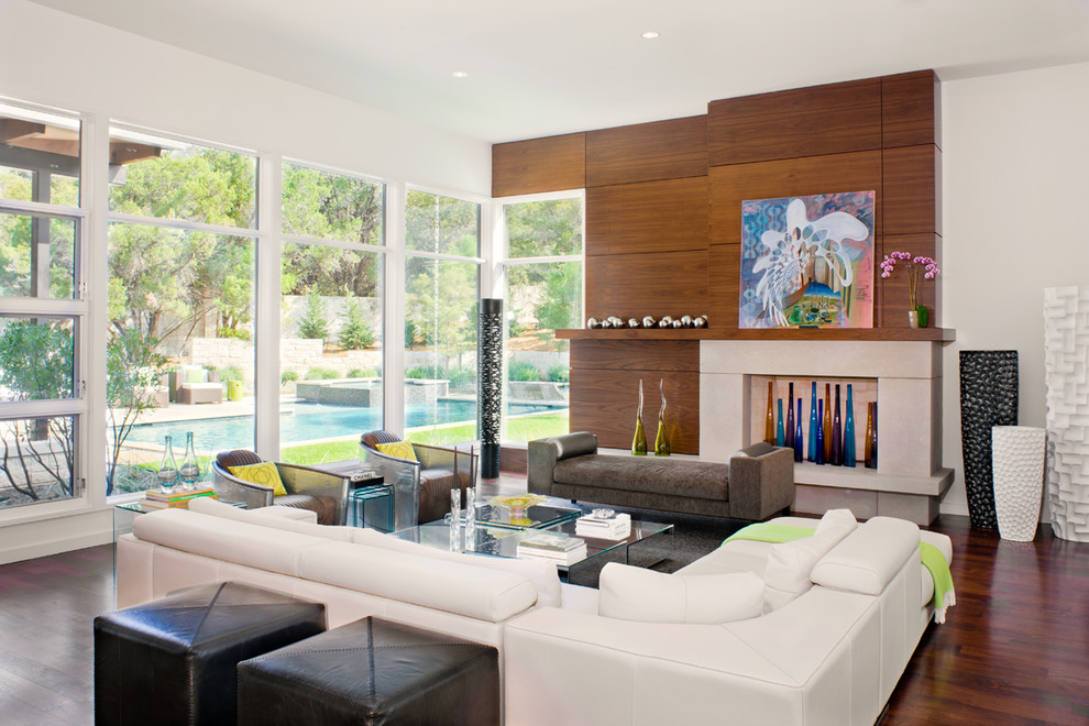 Example of a trendy formal and open concept medium tone wood floor living room design in Austin with white walls, a standard fireplace and a stone fireplace