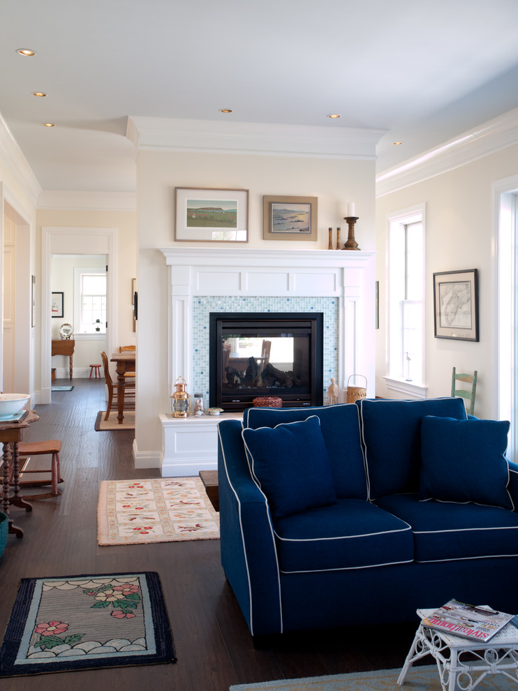 Example of a beach style open concept dark wood floor living room design in Other with white walls, a two-sided fireplace and a tile fireplace