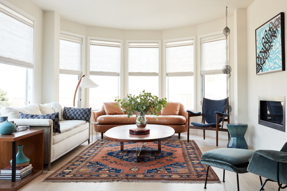 Example of a trendy light wood floor living room design in San Francisco with beige walls and a ribbon fireplace