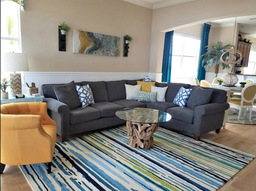 Design ideas for a beach style formal open concept living room in Orlando with beige walls, light hardwood floors, no fireplace and no tv.